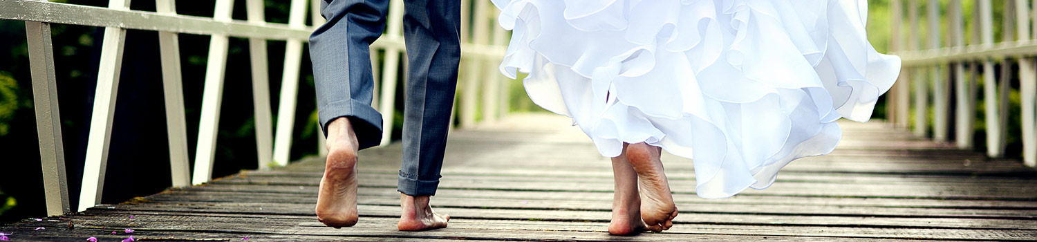 Bride & Groom walking on the deck